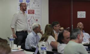 Media Image : Deputy Cluster Coordinator John Myraunet guides the debate